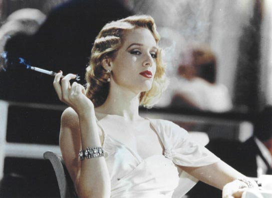 Penelope Ann Miller smoking a cigarette (or weed)